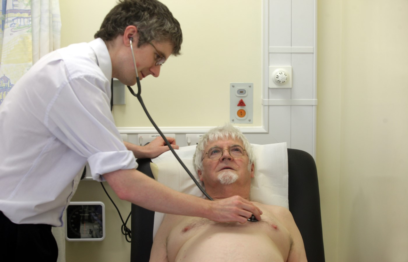 Man receiving chest examination from doctor