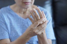 Woman rubbing hands arthritis