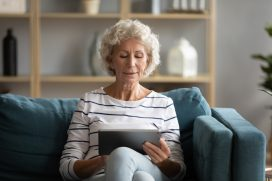 Woman inputting health data into a tablet device