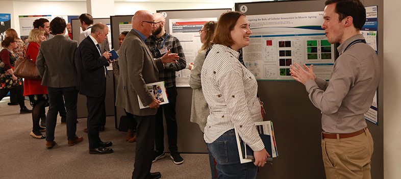 Image of postgraduate students sharing research through posters