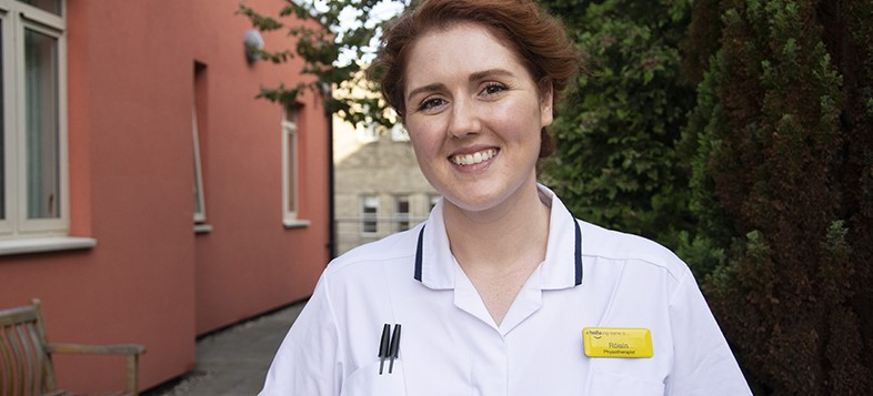 Image of Róisín Fallen-Bailey standing in front of a building at Newcastle Hospitals